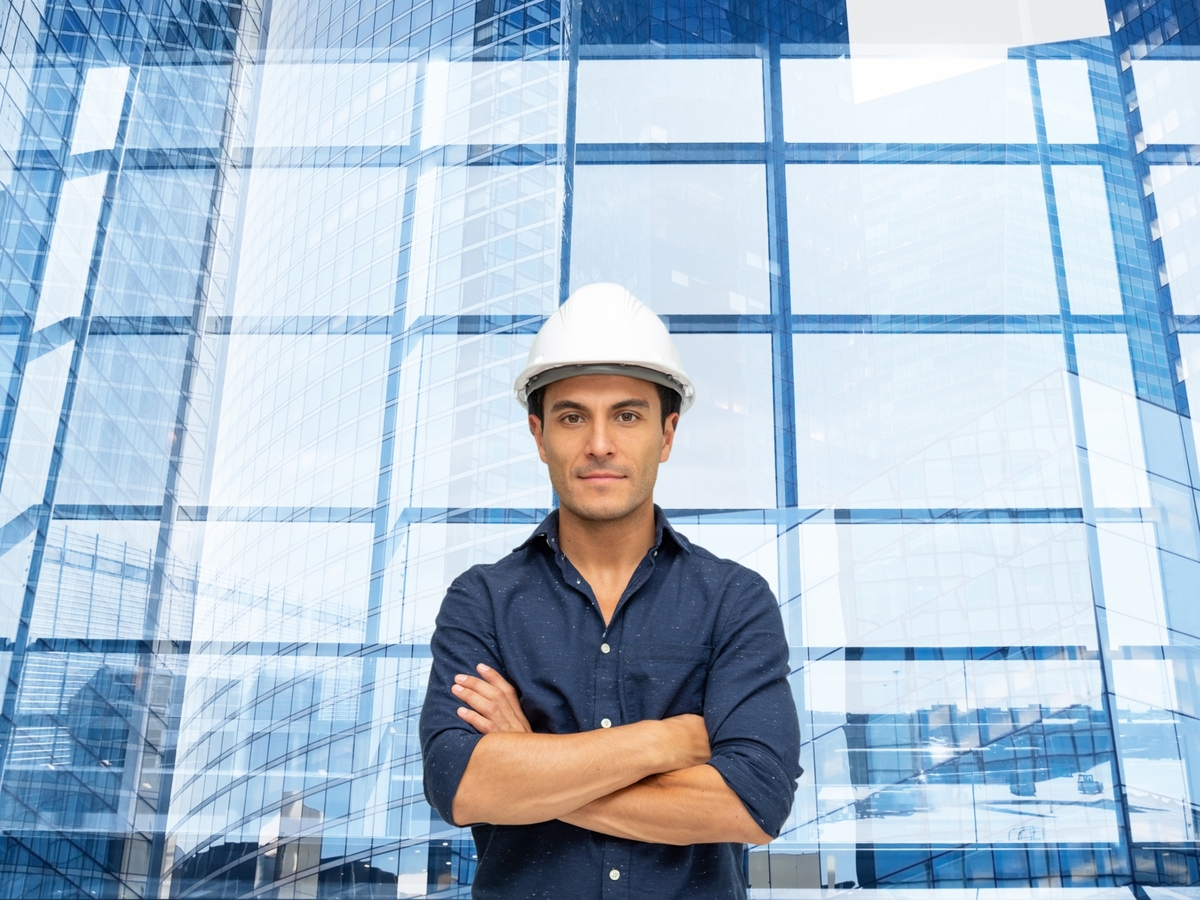 Engineer standing in front of office building