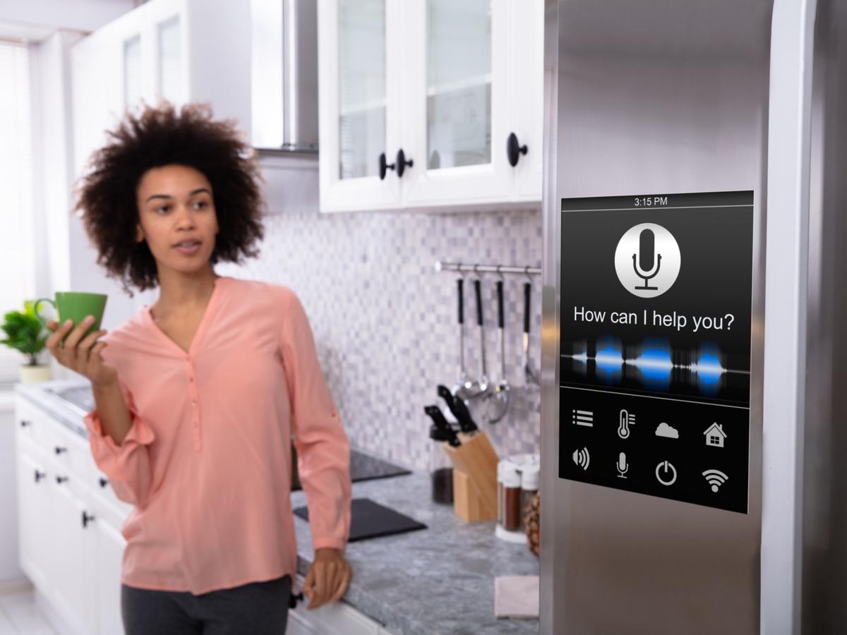 Woman looking at smart refrigerator