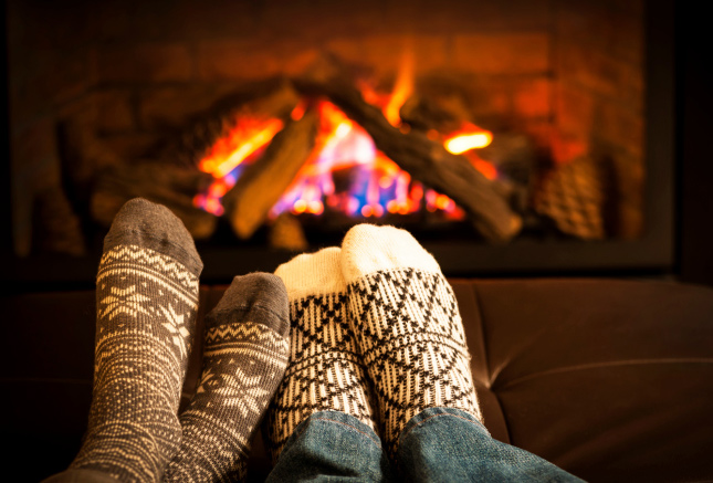 Lower the thermostat when using your fireplace